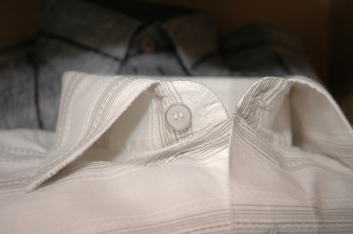 Unbuttoned white striped shirt collar
