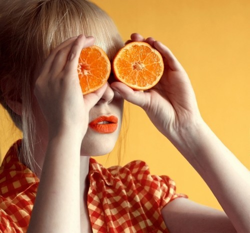 Orange slices over eyes