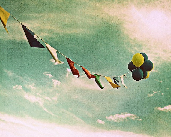 balloons and banner in sky