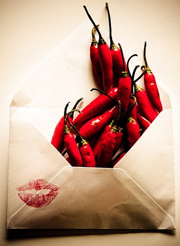 red lipstick on letter chili peppers