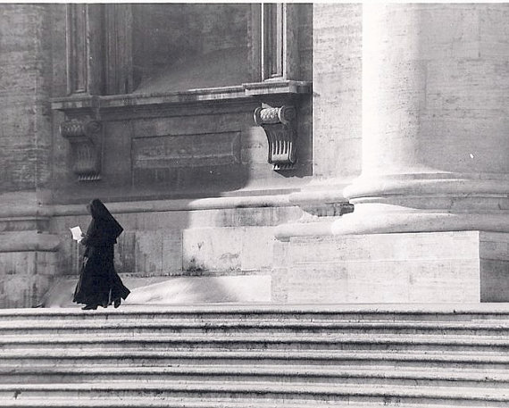 Nun Walking along Steps of St Peters Basilica