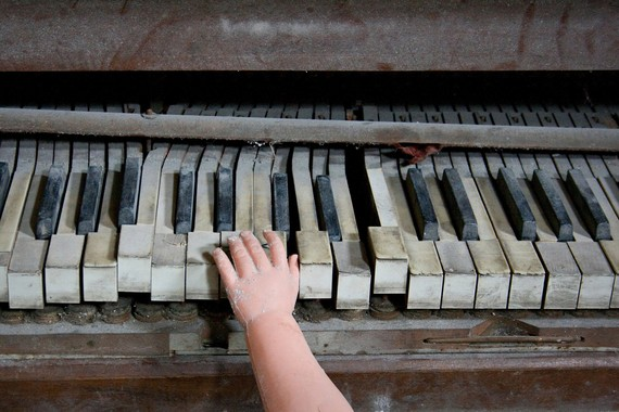 Creepy Piano Baby abandoned decay urban piano doll Detroit