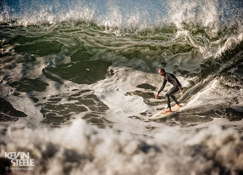 Surfer riding a wave at Rincon Point in Santa Barbara, California.