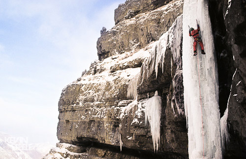 Ice climber on vertical ice pillar, Provo Canyon, Utah