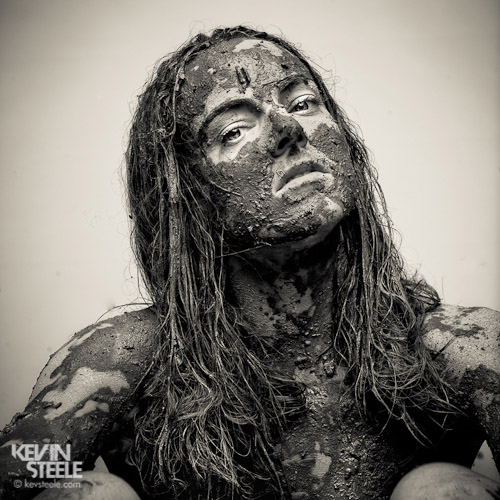 young woman with mud on her face