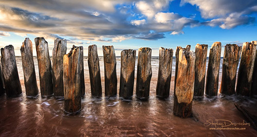 An abandoned pier under a summer sky along the coast of Prince Edward Island - Canada