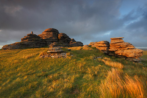 Golden light across the Great Links Tor of Dartmoor in Southwest England.
