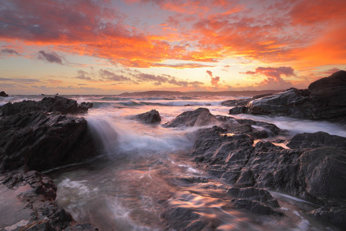 The waters of Heybrook Bay during a breathtaking sunset, Southwest England