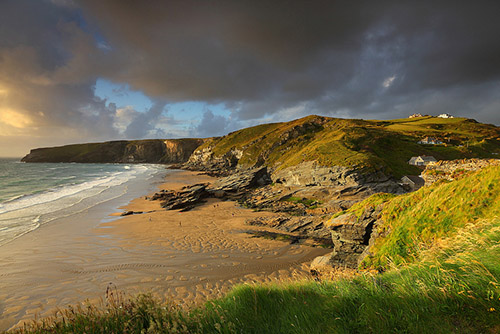 The sandy beach of Trebarwith Strand, as seen with beautiful golden light - Southwest England