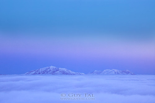 """Ethereal Evening"" by landscape photographer Guy Tal; blue hour image of snow and mountains"