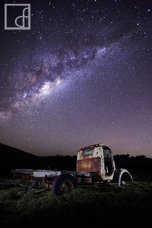 Astro-photograph of the Milky Way under a vintage pick-up truck, in Australia
