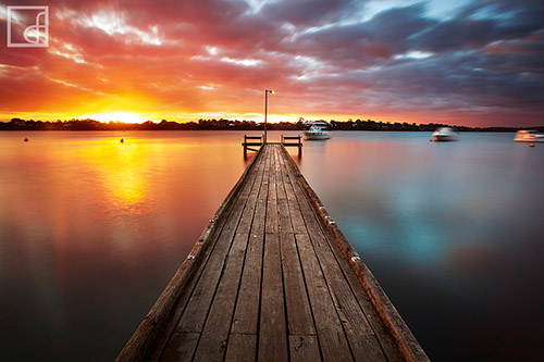 Colorful sunset over a long pier in Australia