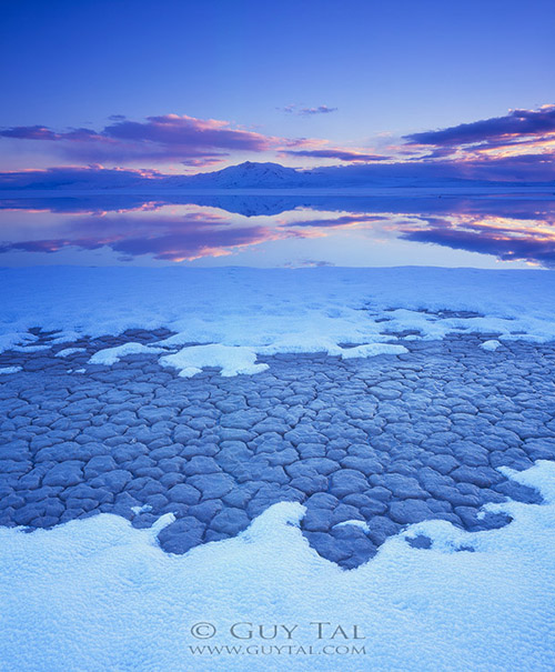 """Winter Island"" by Guy Tal - blue hour image of snow and sand."