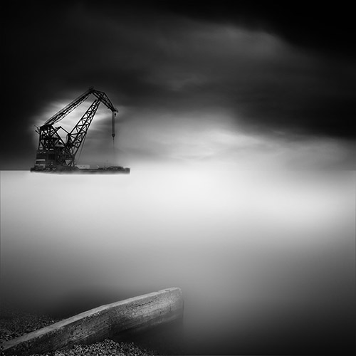 Floating construction crane, long exposure in black and white.