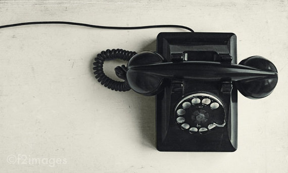 Connected black vintage telephone