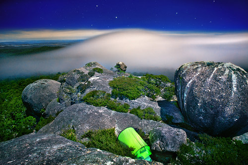 Long exposure of the night sky and foggy clouds, as seen from Cathedral Rock in Australia.
