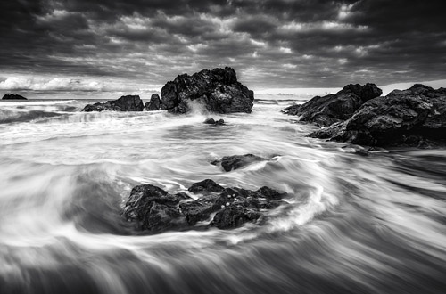 Black and white image of the Australian coast, long exposure.