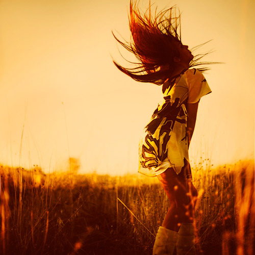 Woman with flowing hair at the golden hour; fine art photography by Ebru Sidar