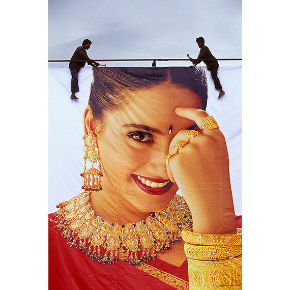 Hanging a Gold Hoarding in Kerala