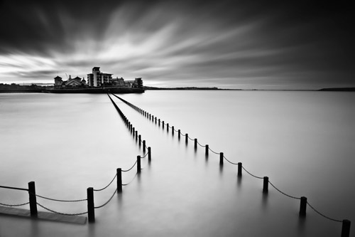 Long exposure black and white of the coastline in Weston Super-Mare, England by Spencer Brown