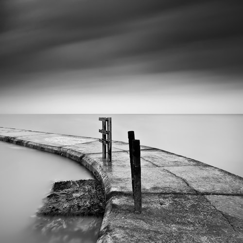 Black and white photo of the old tidal pool in Margate, England by Spencer Brown