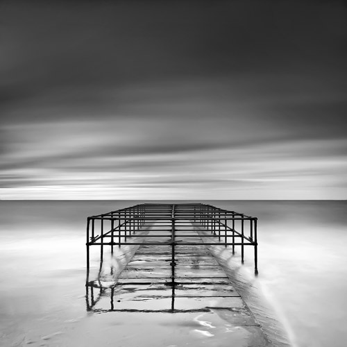 Protective sea cage on Bournemouth beach in England by Spencer Brown