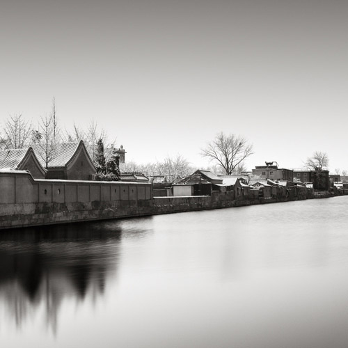 Long exposure of waterfront homes, fine art black and white photography.