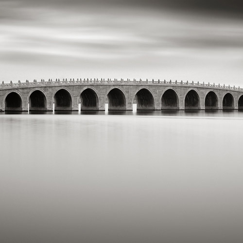 Long exposure of a bridge with much detail, black and white fine art photography.