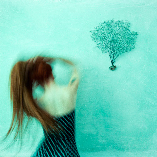 Long exposure of woman with long red hair; fine art photography by Ebru Sidar