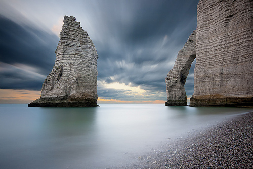 Two imposing rocks under a dramatic stormy sky, by Nicolas Rottiers
