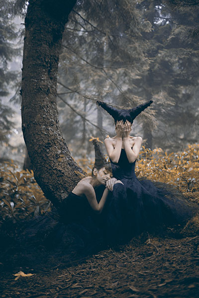 Two women sit in a forest, fine art photography by Ebru Sidar