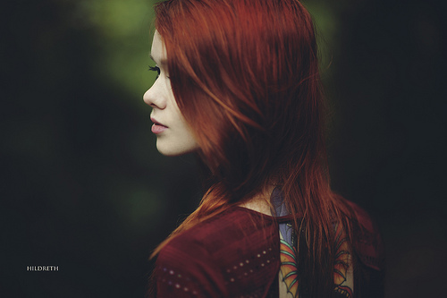A red-headed woman stares into the unknown - fine art portrait by Charles Hildreth