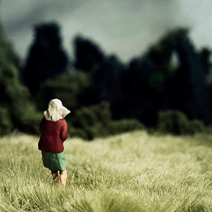 The Clearing grass field with girl in forest clearing