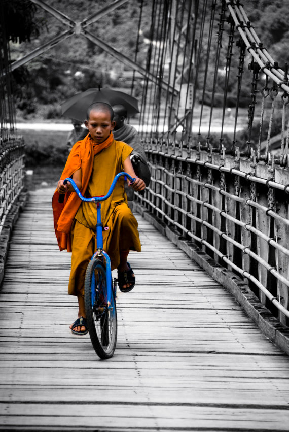 Monk on a blue Bicycle
