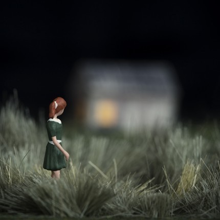 Outskirts miniature figure redhead girl outside house at night