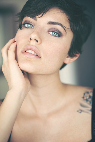 A tattooed woman looks intensely into the camera - fine art portrait by Charles Hildreth