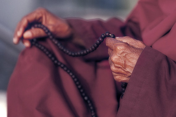 Buddhist Monk with Prayer Beads