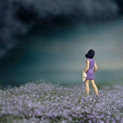 May rain clouds, lavender fields and girl in purple