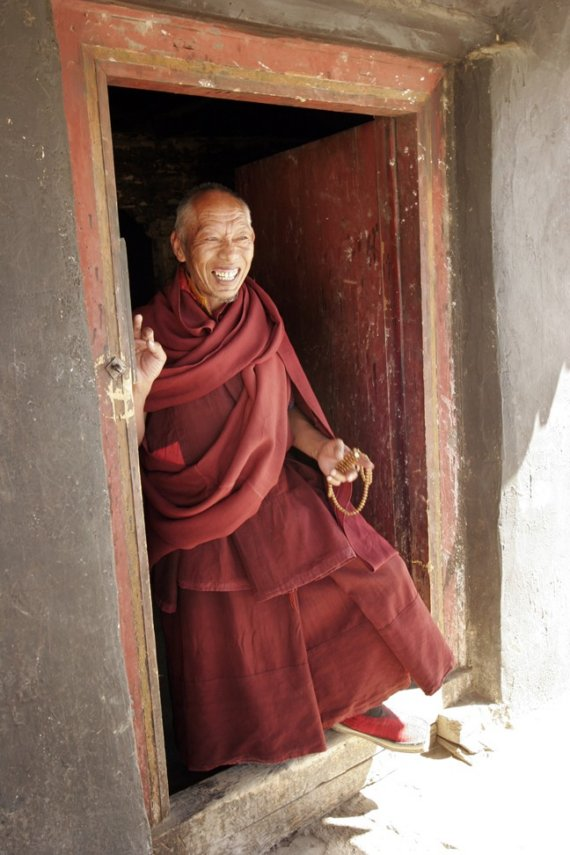 Monk in doorway, Tibet