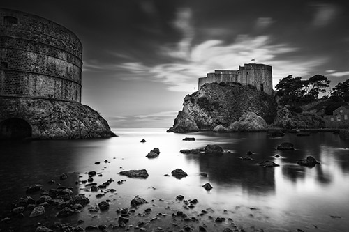 King's Landing - A black and white waterscape of stone castles on islands.