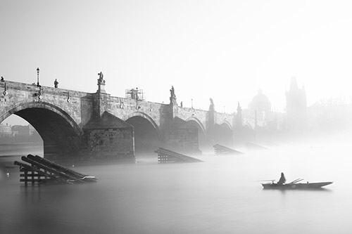 A misty view of the Charles Bridge in Prague