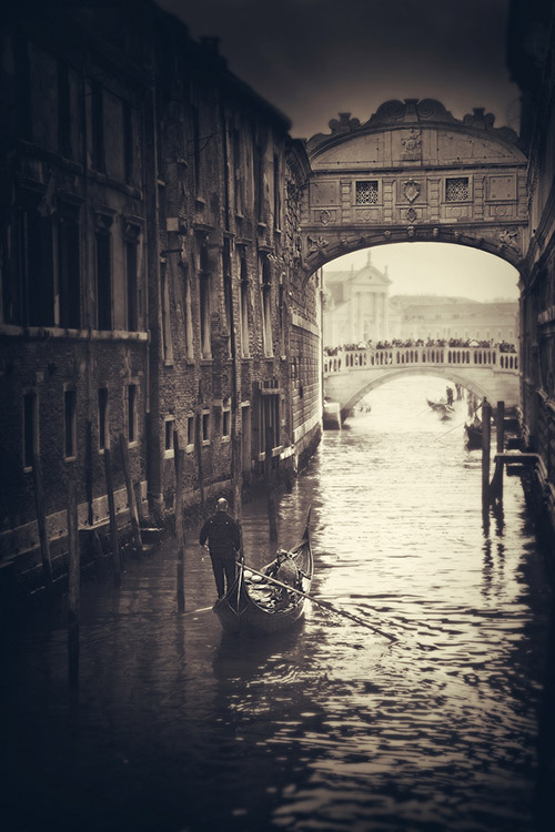The canals of Venice, shown in a nostalgic tone.