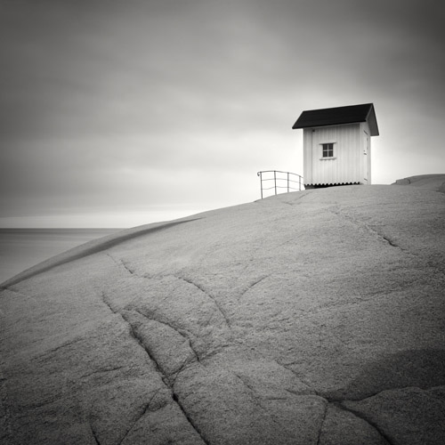 White house by the sea, black and white image by Hakan Strand