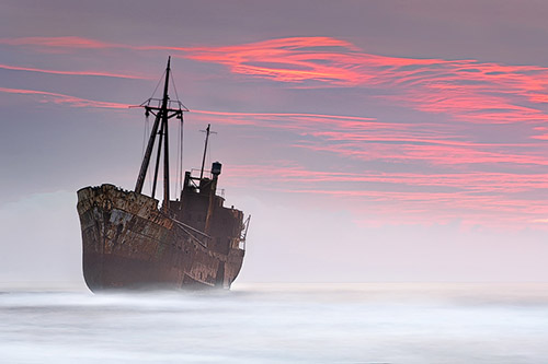 The Dark Traveller - an abandoned shipreck under a pastel sky