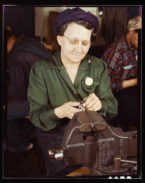 War production worker at the Vilter Manufacturing Company making M5 and M7 guns for the U.S. Army, Milwaukee, Wis. Ex-housewife, age 49, now doing bench work on small gun parts. Son is Second Lieutenant, Son-in-law, Captain in Army