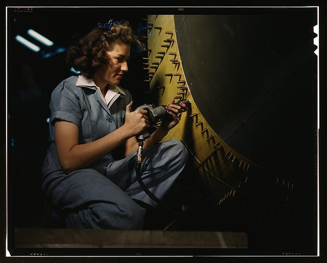 Riveter at work on Consolidated bomber, Consolidated Aircraft Corp., Fort Worth, Texas