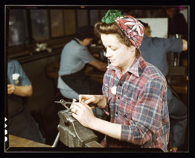 One of the girls of Vilter Manufacturing Co. filing small gun parts, Milwaukee, Wisc. One brother in Coast Guard, one going to Army.