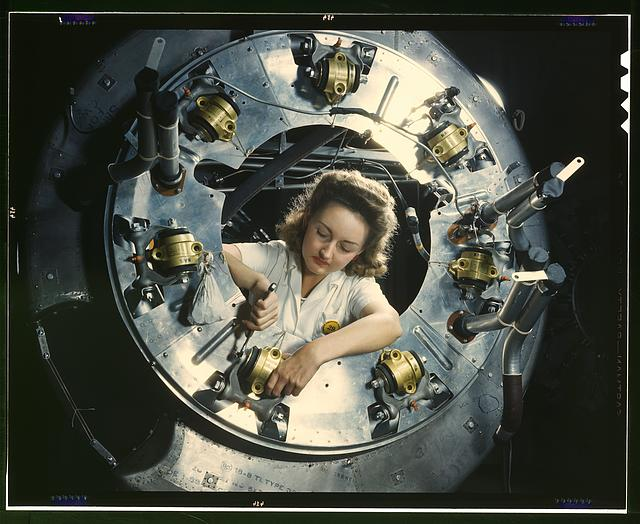 Part of the cowling for one of the motors for a B-25 bomber is assembled in the engine department of North American Aviation, Inc.'s Inglewood, Calif., plant