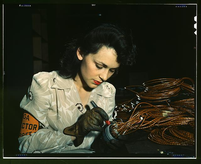 Woman aircraft worker, Vega Aircraft Corporation, Burbank, Calif. Shown checking electrical assemblies
