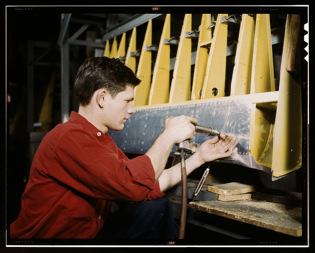 Riveter at work at the Douglas Aircraft Corporation plant in Long Beach, Calif.